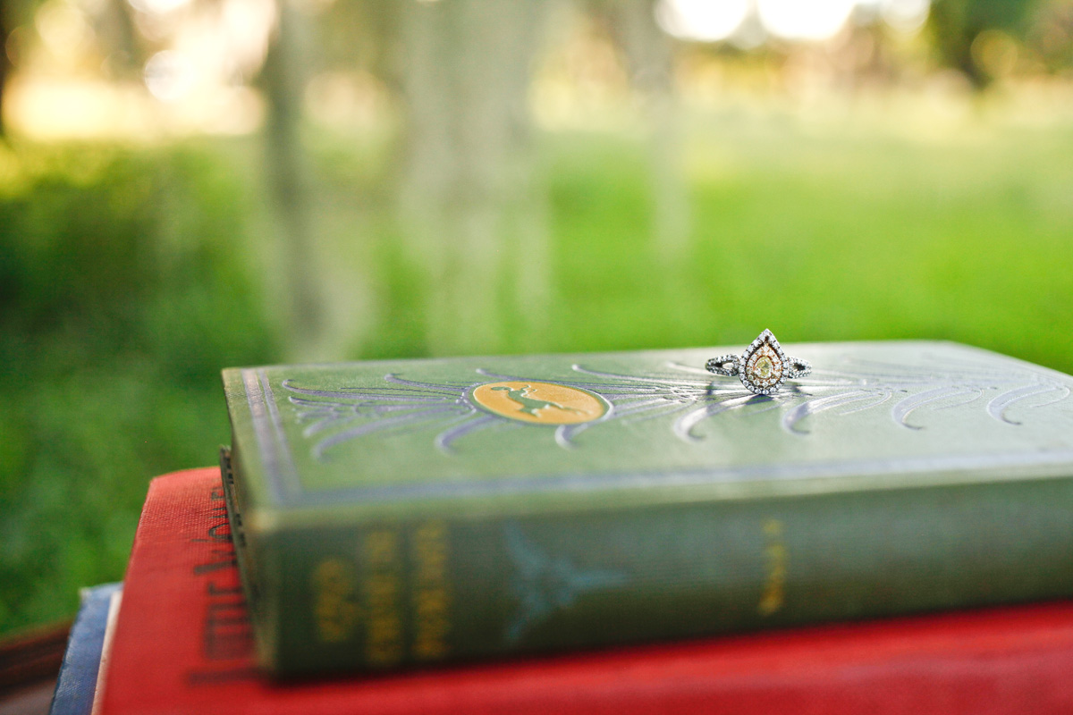Engagement Ring on Vintage Books | The Majestic Vision Wedding Planning | Riverbend Park in Palm Beach, FL | www.themajesticvision.com | Krystal Zaskey Photography