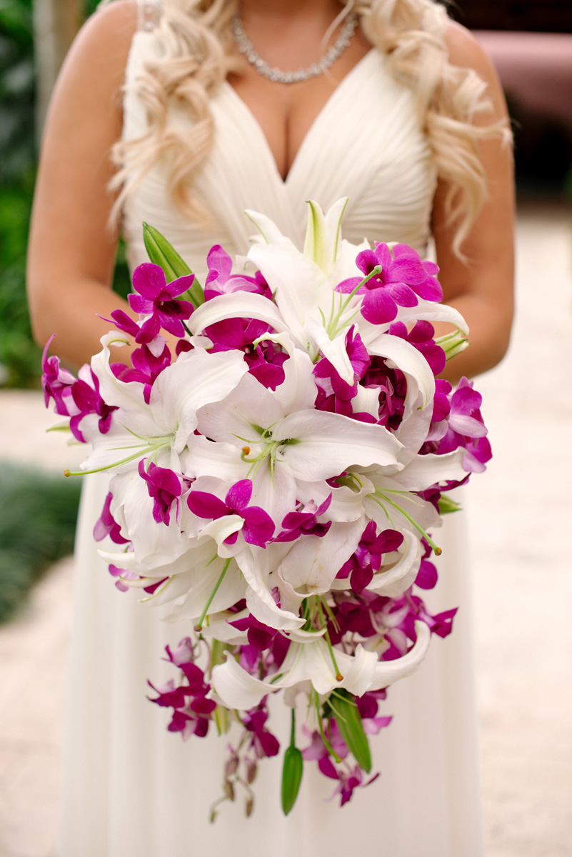 Stunning Cascade Bridal Bouquet with Purple Orchids and White Lillies | The Majestic Vision Wedding Planning | The Addison Boca in Palm Beach, FL | www.themajesticvision.com | Starfish Studios