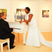 Romantic Bridal Portrait with Groom Serenading the Bride at 32 East in Palm Beach, FL thumbnail