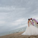 Elegant Bridal Portrait on the Beach at Sailfish Marina in Palm Beach, FL thumbnail