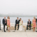 Elegant Bridal Party Portrait with Milwaukee Art Museum Background at Pritzlaff Building in Milwaukee, WI thumbnail