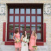 Elegant Bridal Party Portrait with Brick Background at Pritzlaff Building in Milwaukee, WI thumbnail