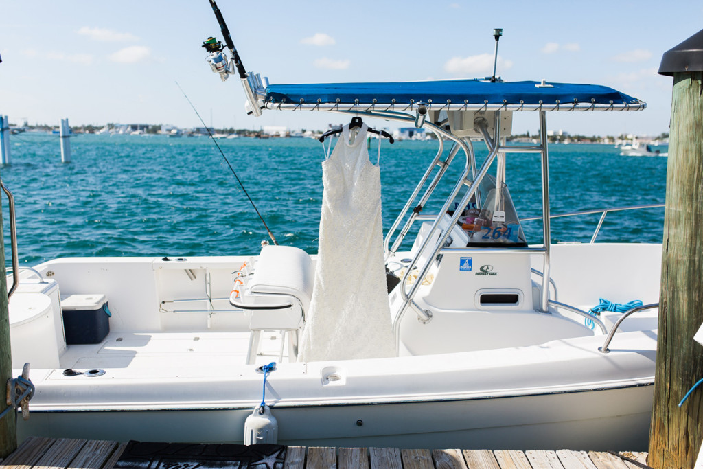 Elegant Waterfront Wedding with the Wedding Dress Hanging from a Boat | The Majestic Vision Wedding Planning | Sailfish Marina in Palm Beach, FL | www.themajesticvision.com | Chris Kruger Photography