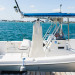Elegant Waterfront Wedding with the Wedding Dress Hanging from a Boat at Sailfish Marina in Palm Beach, FL thumbnail