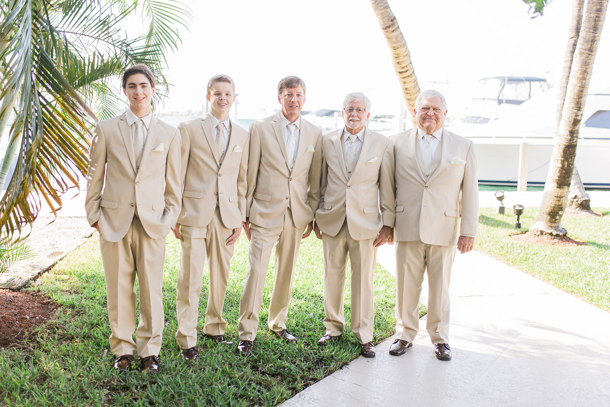 Elegant Bridal Party in Cream Suits | The Majestic Vision Wedding Planning | Sailfish Marina in Palm Beach, FL | www.themajesticvision.com | Chris Kruger Photography