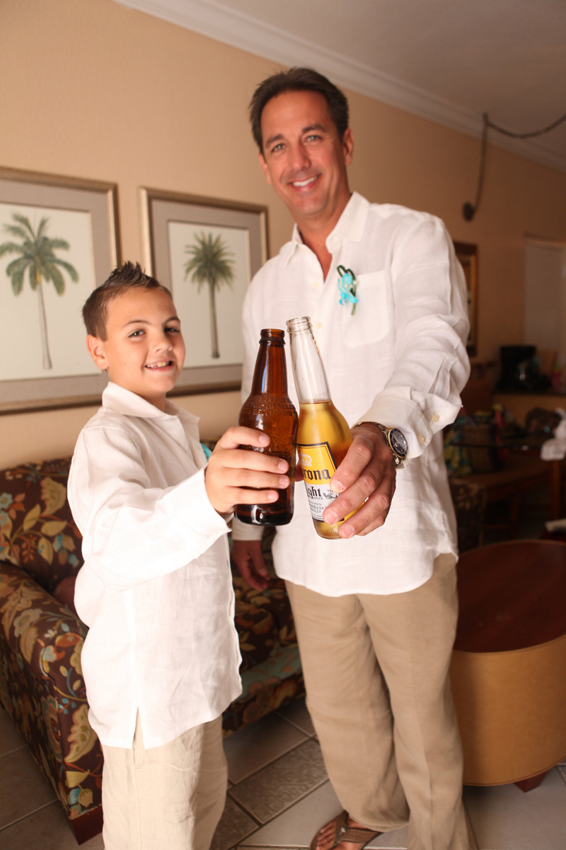 Handsome Groom Getting Ready with Ring Bearer | The Majestic Vision Wedding Planning | Palm Beach Shores in Palm Beach, FL | www.themajesticvision.com | Krystal Zaskey Photography