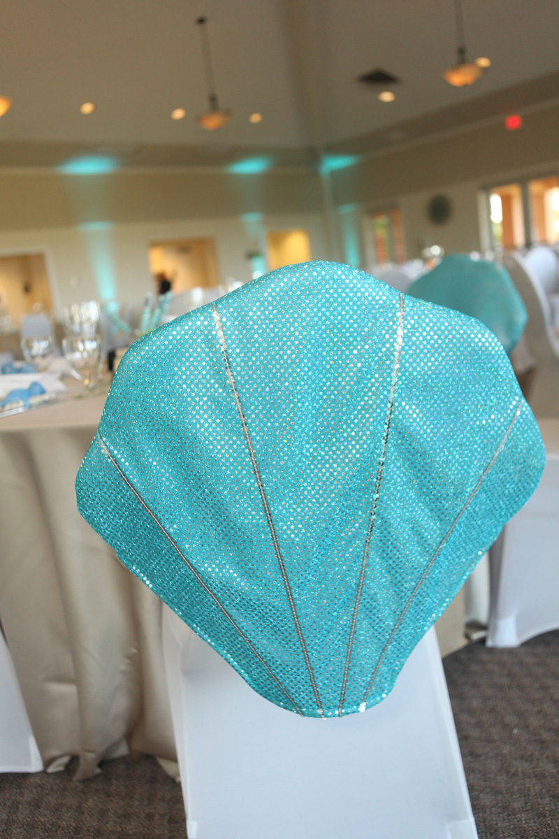 Whimsical Seashell Chair Cover for Kids Table | The Majestic Vision Wedding Planning | Palm Beach Shores in Palm Beach, FL | www.themajesticvision.com | Krystal Zaskey Photography