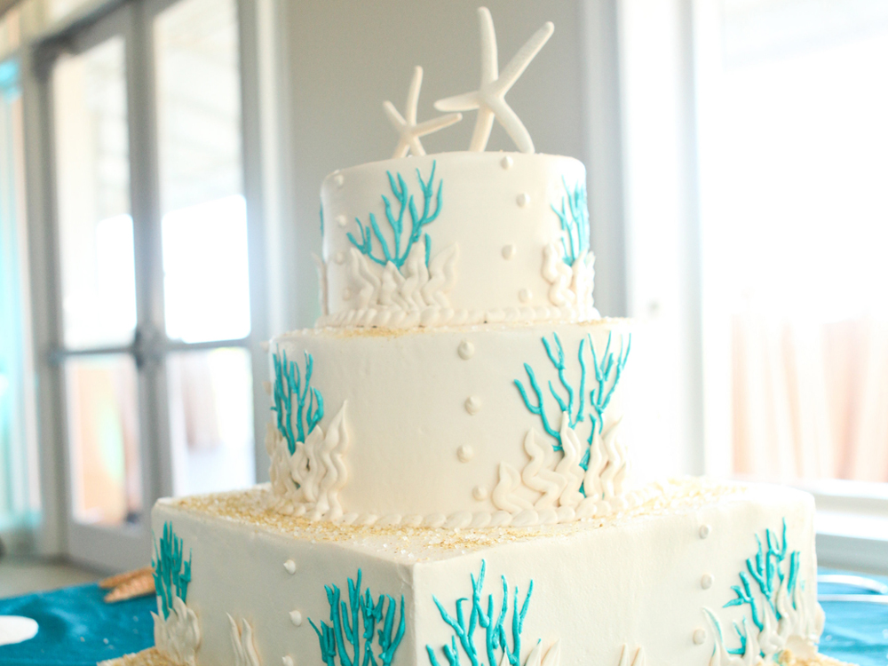 Whimsical Wedding Cake with Coral and Starfish | The Majestic Vision Wedding Planning | Palm Beach Shores in Palm Beach, FL | www.themajesticvision.com | Krystal Zaskey Photography