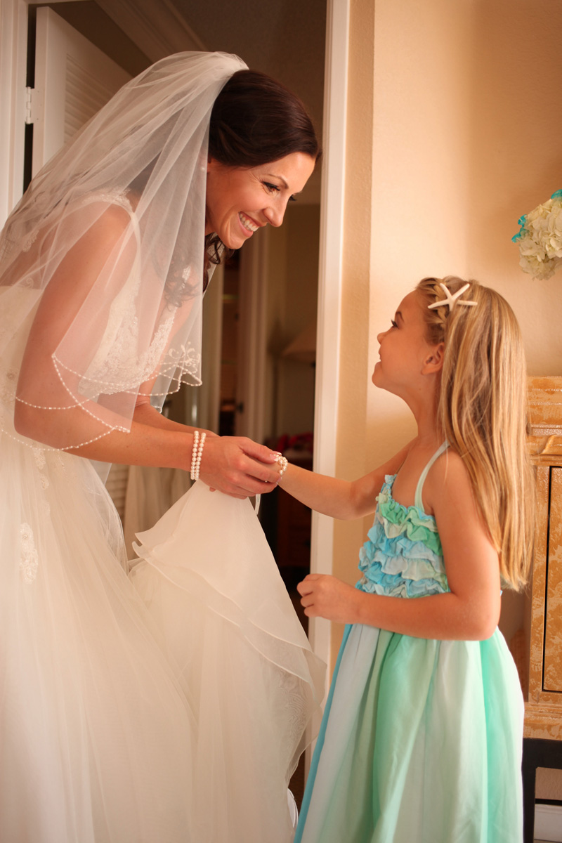 Elegant Bride Getting Ready with Flower Girl | The Majestic Vision Wedding Planning | Palm Beach Shores in Palm Beach, FL | www.themajesticvision.com | Krystal Zaskey Photography