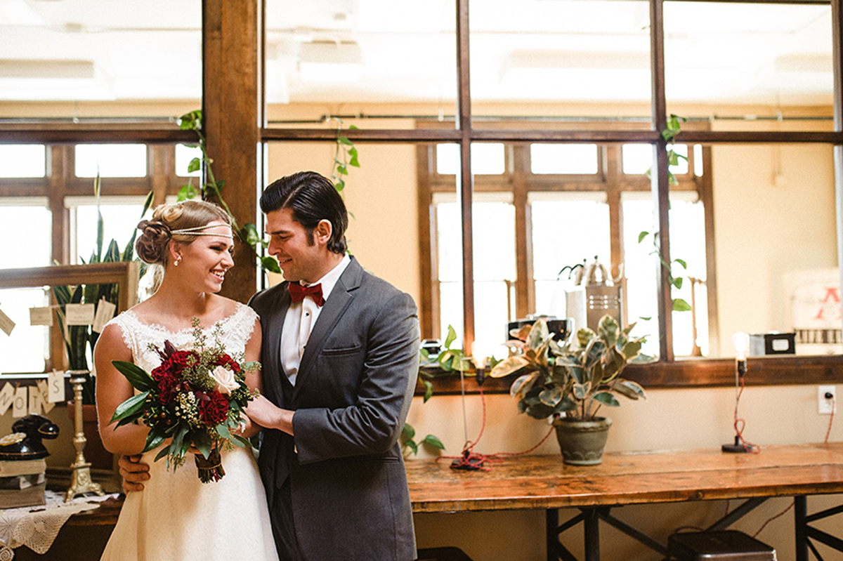 Stunning Bride in Mikaella Gown with Elegant Marsala Bridal Bouquet with Roses and Dahlias | The Majestic Vision Wedding Planning | Anodyne Coffee in Milwaukee, WI | www.themajesticvision.com | Elizabeth Haase Photography