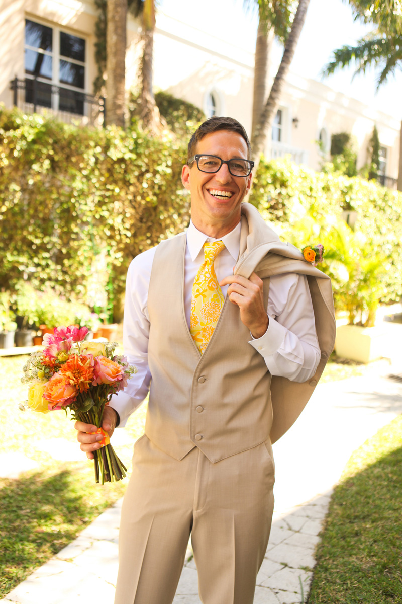 Handsome Groom with Elegant Lilly Pulitzer Inspired Bridal Bouquet with Orange, Yellow and Pink Flowers | The Majestic Vision Wedding Planning | The Colony Hotel in Palm Beach, FL | www.themajesticvision.com | Krystal Zaskey Photography