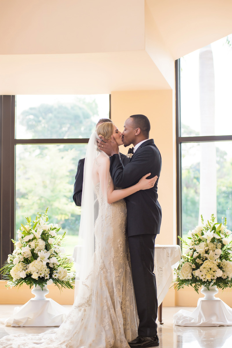 Elegant Interracial Couple First Kiss | The Majestic Vision Wedding Planning | The Borland Center in Palm Beach, FL | www.themajesticvision.com | Enduring Impressions Photography