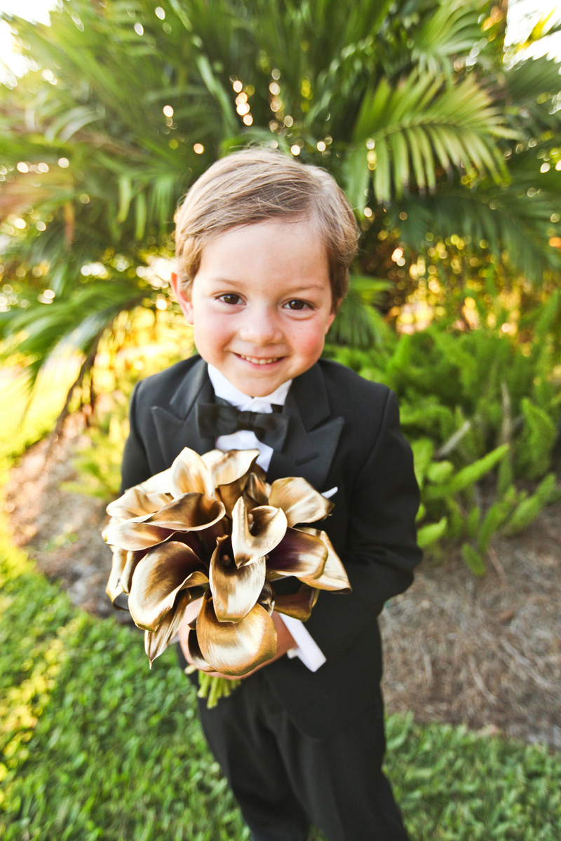 Adorable Ring Bearer Holding Modern Bridal Bouquet with Gold Tulips Wrapped in Black and White Fabric | The Majestic Vision Wedding Planning | Breakers West in Palm Beach, FL | www.themajesticvision.com | Krystal Zaskey Photography