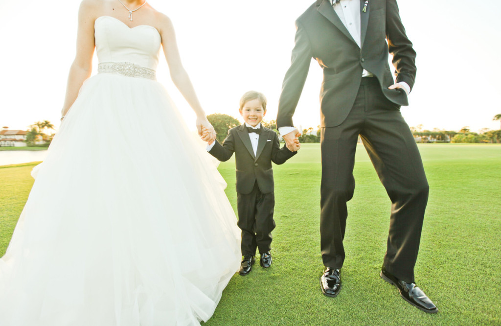 Adorable Ring Bearer with Bride and Groom on Golf Course | The Majestic Vision Wedding Planning | Breakers West in Palm Beach, FL | www.themajesticvision.com | Krystal Zaskey Photography
