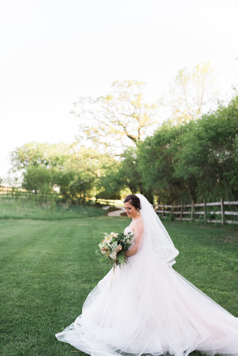 Beautiful Bride in Blush Tara Keely Gown Carrying Elegant Bridal Bouquet with Cream, Blush and Pink Flowers | The Majestic Vision Wedding Planning | Rustic Manor in Milwaukee, WI | www.themajesticvision.com | Elizabeth Haase Photography