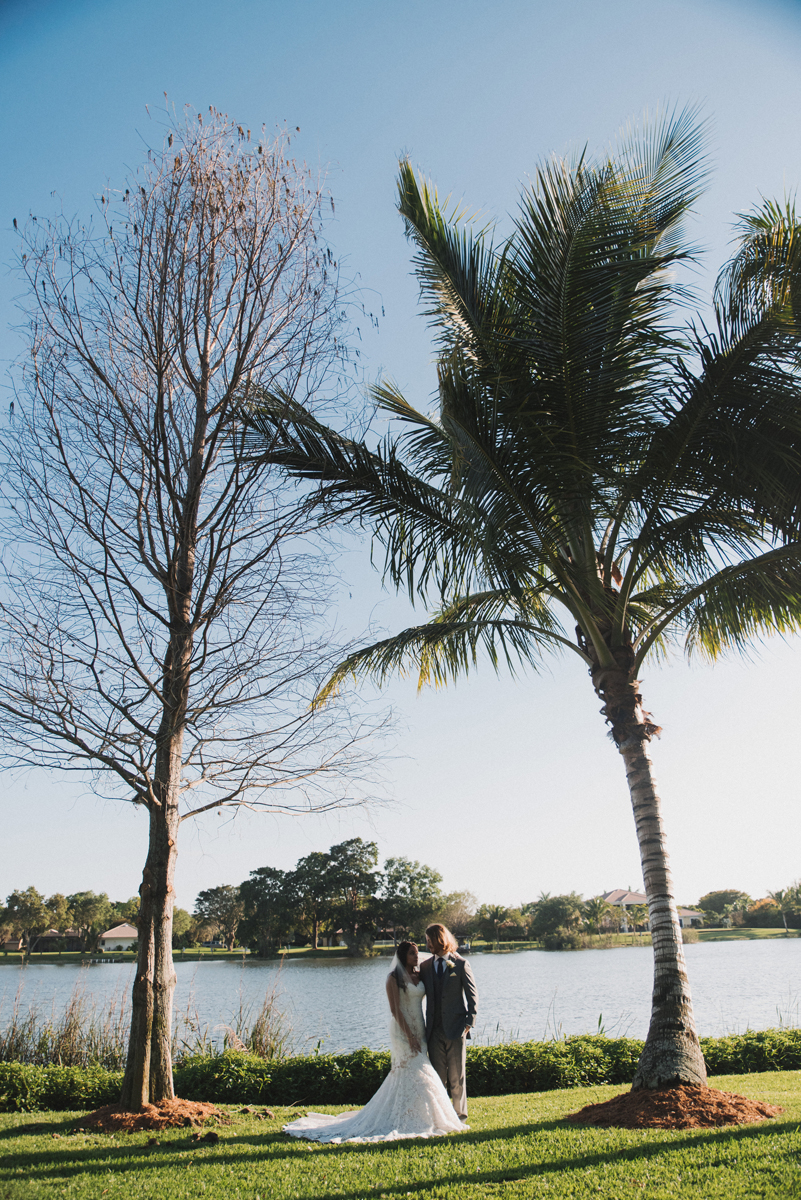 Elegant Couple Portrait Under a Palm Tree | The Majestic Vision Wedding Planning | Palm Beach, FL | www.themajesticvision.com | Robert Madrid Photography