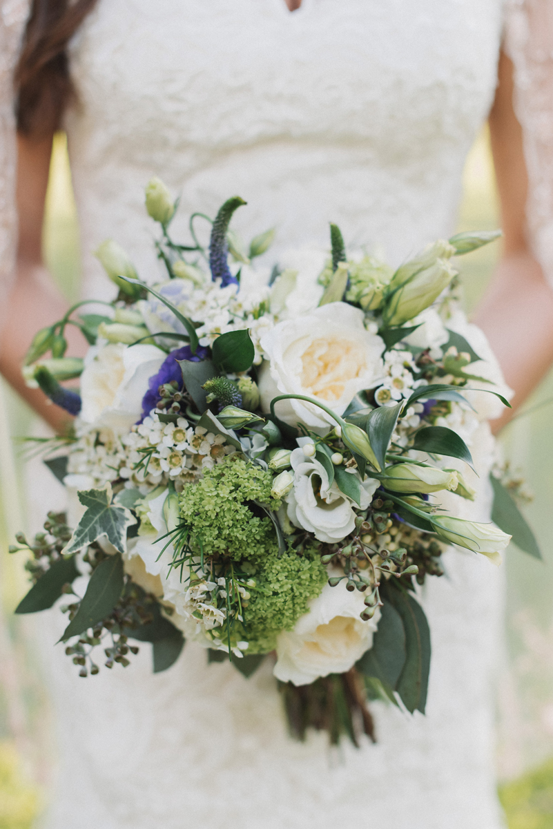 Elegant Bridal Bouquet of White Roses, Green Vibernum and Purple Lisianthus | The Majestic Vision Wedding Planning | Palm Beach, FL | www.themajesticvision.com | Robert Madrid Photography