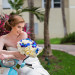 Fun Bridal Portrait on Blue Moped at Grand Bay Club in Key Biscayne, FL thumbnail
