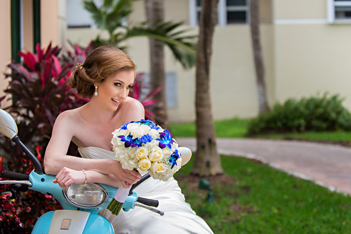 Fun Bridal Portrait on Blue Moped | The Majestic Vision Wedding Planning | Grand Bay Club in Key Biscayne, FL | www.themajesticvision.com | Emindee Images