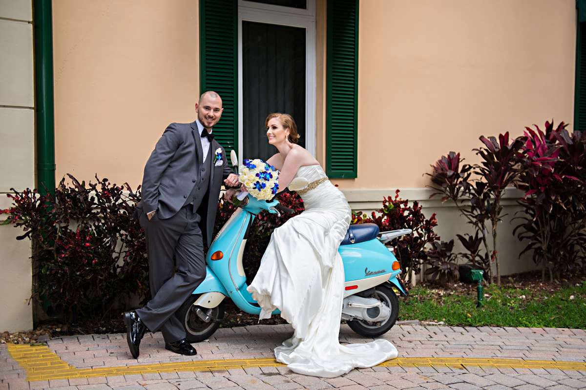 Fun Couple Portrait on Blue Moped | The Majestic Vision Wedding Planning | Grand Bay Club in Key Biscayne, FL | www.themajesticvision.com | Emindee Images