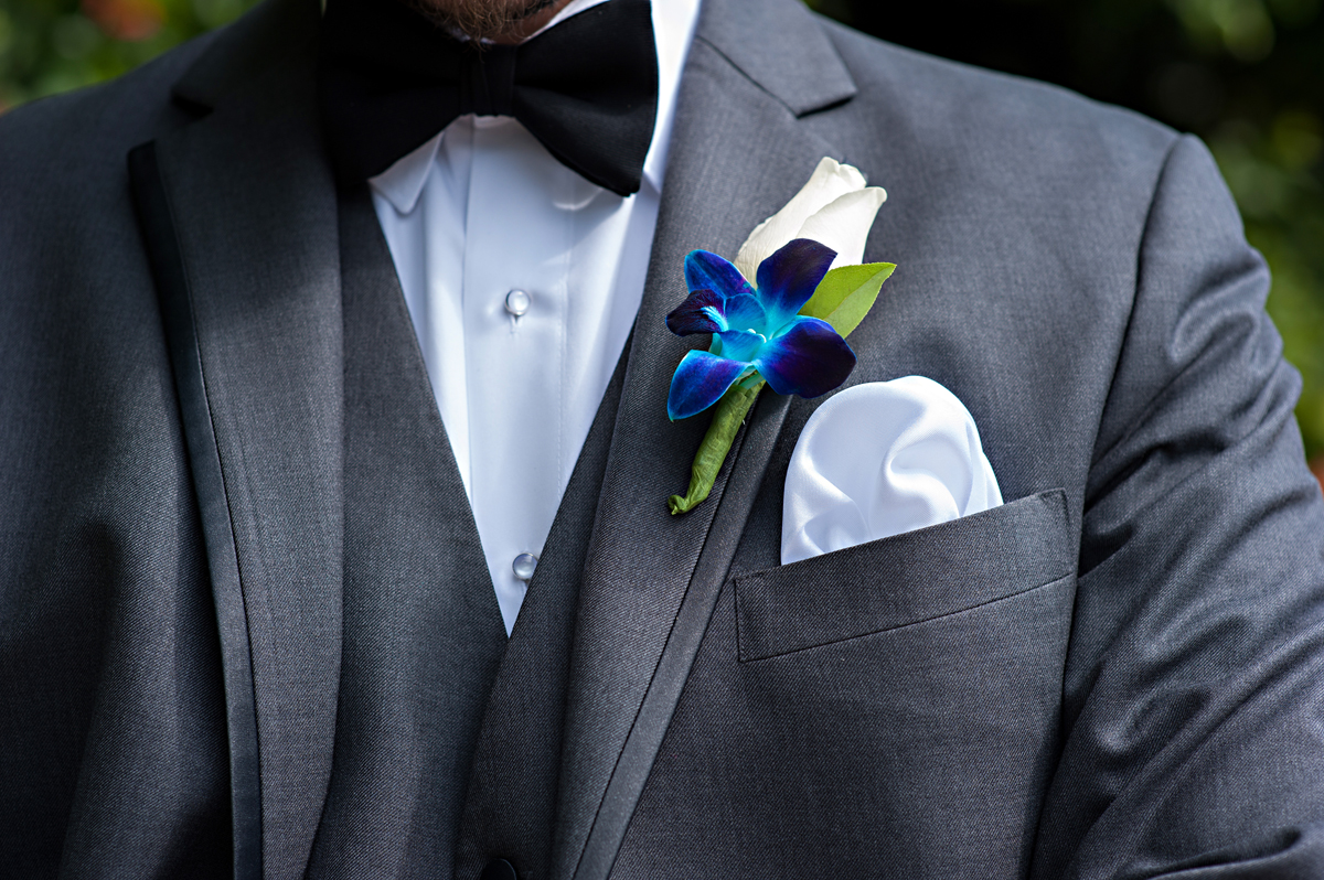 Elegant Blue Orchid and White Rose Groom Boutineer | The Majestic Vision Wedding Planning | Grand Bay Club in Key Biscayne, FL | www.themajesticvision.com | Emindee Images