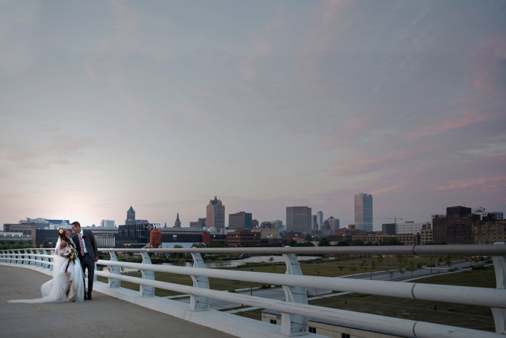 Romantic Bride and Groom with Milwaukee Skyline | The Majestic Vision Wedding Planning | Iron Horse Hotel in Milwaukee, WI | www.themajesticvision.com | Shannon Wucherer Photography