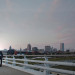 Romantic Bride and Groom with Milwaukee Skyline at Iron Horse Hotel in Milwaukee, WI thumbnail