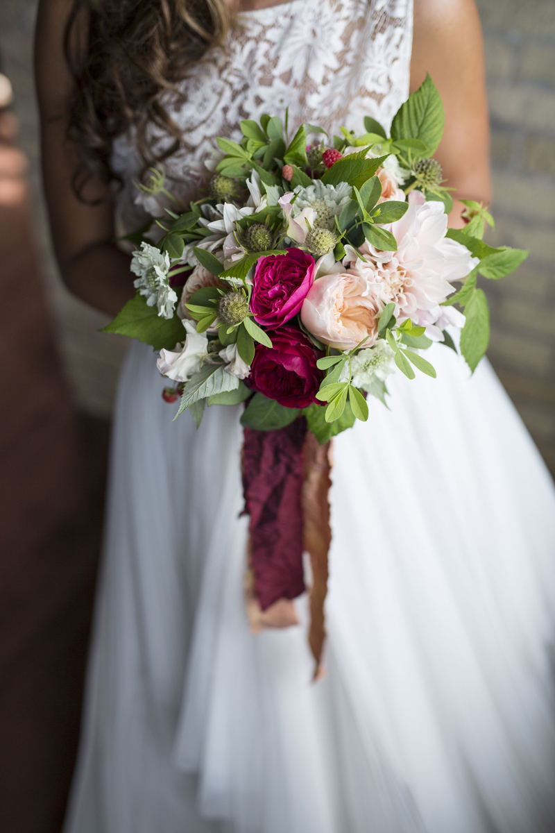 Romantic Bridal Bouquet with Red and Cream Roses | The Majestic Vision Wedding Planning | Iron Horse Hotel in Milwaukee, WI | www.themajesticvision.com | Shannon Wucherer Photography