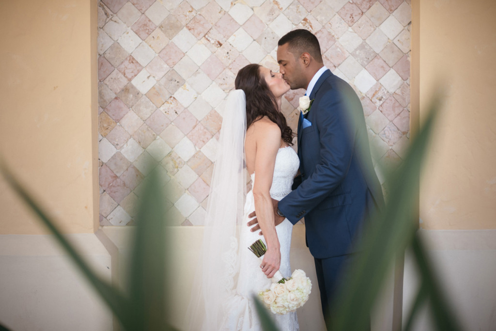 First Look Kiss at Wine Themed Wedding | The Majestic Vision Wedding Planning | The Addison Boca Raton in Boca Raton, FL | www.themajesticvision.com | Robert Madrid Photography