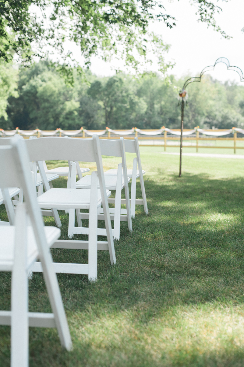 White Ceremony Chairs at Romantic Mint and Serenity Blue Farm Wedding | The Majestic Vision Wedding Planning | Private Residence in Milwaukee, WI | www.themajesticvision.com | Elizabeth Haase Photography