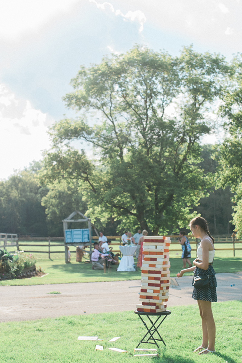 Giant Jenga at Romantic Mint and Serenity Blue Farm Wedding | The Majestic Vision Wedding Planning | Private Residence in Milwaukee, WI | www.themajesticvision.com | Elizabeth Haase Photography