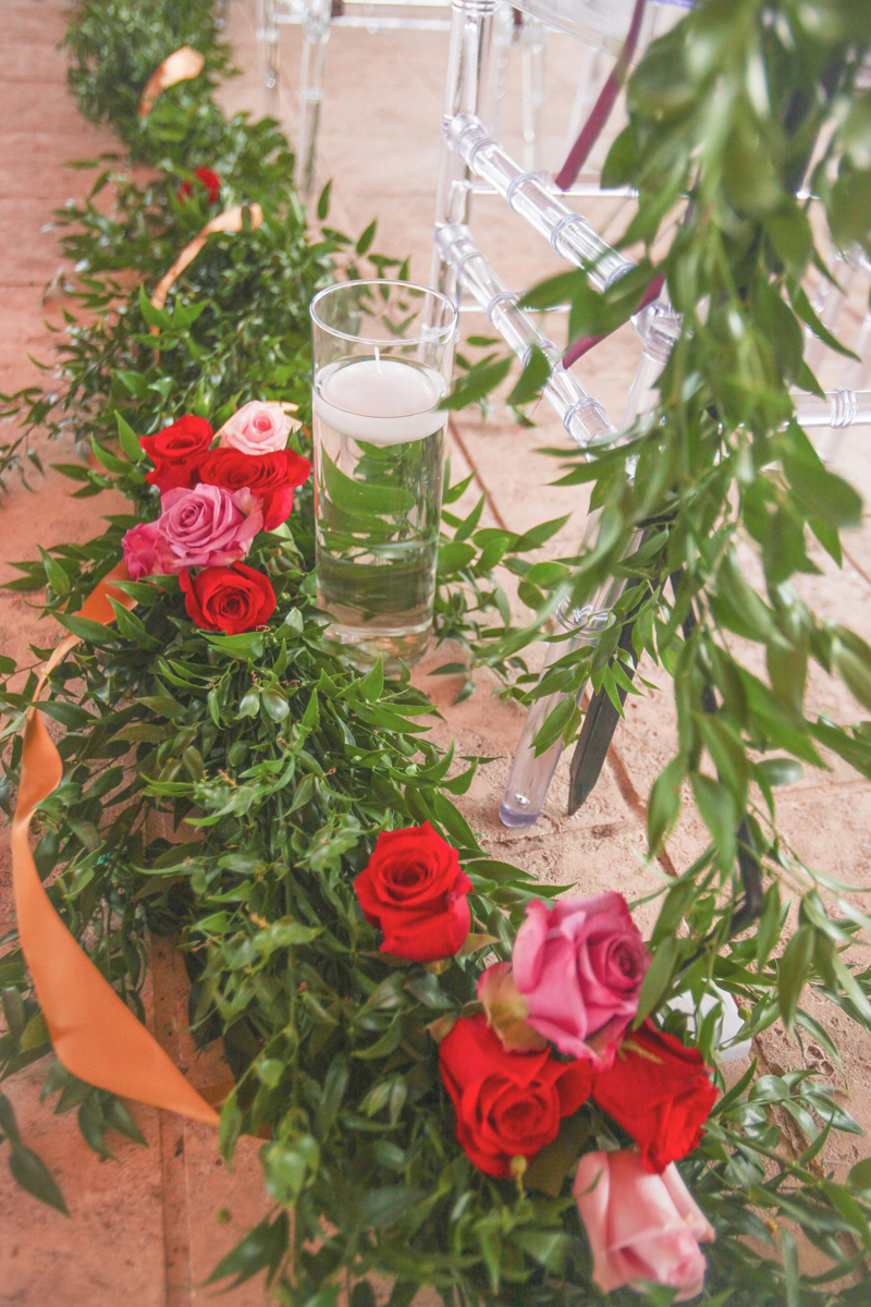 Garland and Rose Aisle Decor for Whimsical Emerald and Amethyst Wedding Ceremony | The Majestic Vision Wedding Planning | The Wanderers Club in Wellington, FL | www.themajesticvision.com | Krystal Zaskey Photography